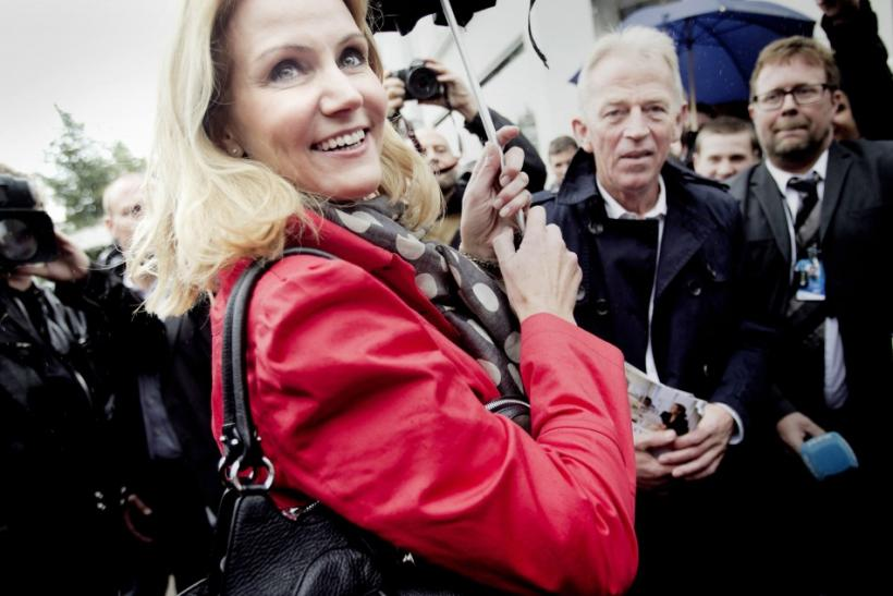 Thorning-Schmidt, leader of Social Democratic Party, and Sovndal, leader of Socialist People's Party, are seen during an election campaign in Copenhagen