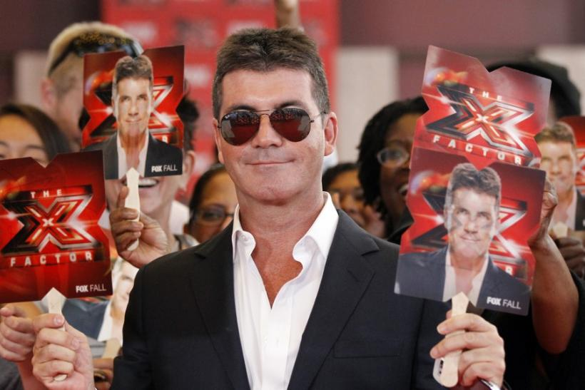 "Simon Cowell poses at the world premiere of ""The X Factor"" in Hollywood"