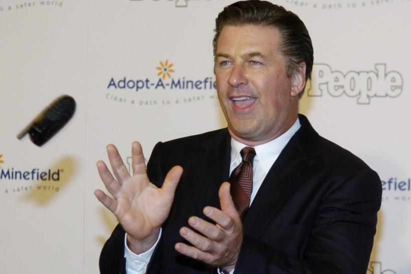 Actor Alec Baldwin catches a cellphone as he arrives for 5th Annual Adopt-A-Minefield Gala in Beverly Hills