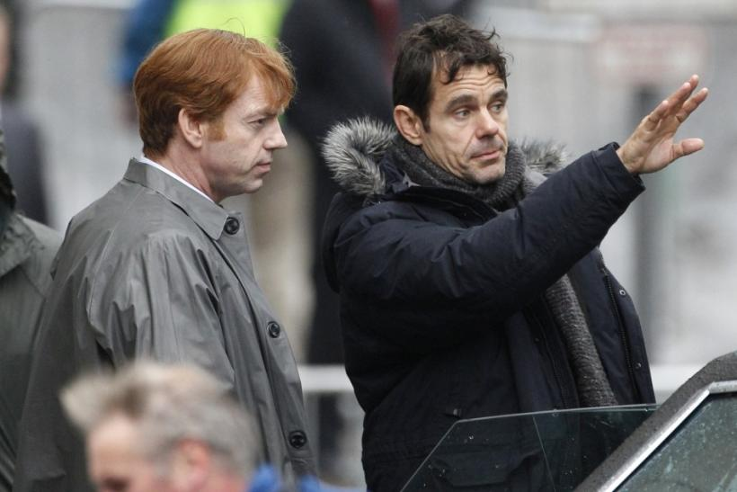 "Actor Hugo Weaving (L) listens to the director Tom Tykwer during filming of ""Cloud Atlas"" in Glasgow, Scotland"