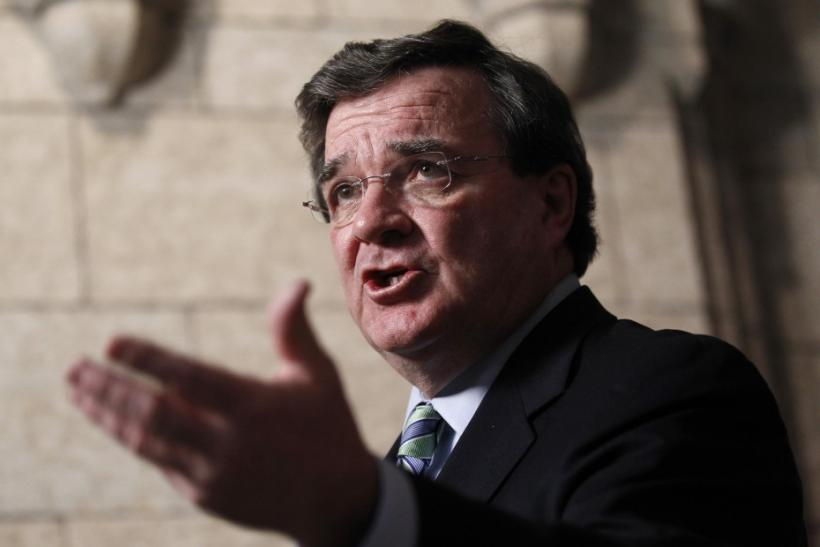 Canada's Finance Minister Flaherty speaks to journalists on Parliament Hill in Ottawa