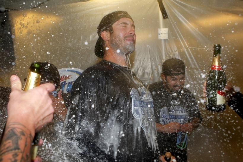 Detroit Tigers pitcher Justin Verlander celebrates in the visitor clubhouse after the Detroit Tigers clinched the American League Central Division after defeating the Oakland Athletics in Oakland