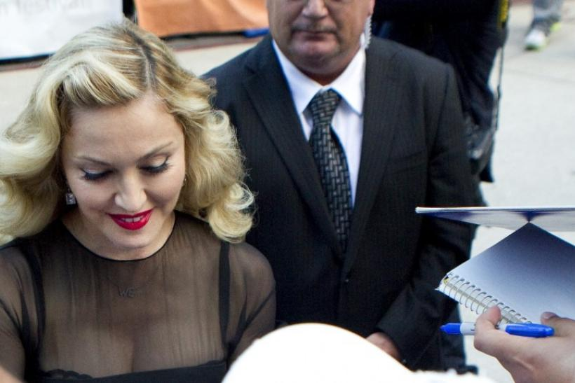 "Director Madonna pauses to sign autographs at the premiere of her film ""W.E."" at the TIFF"