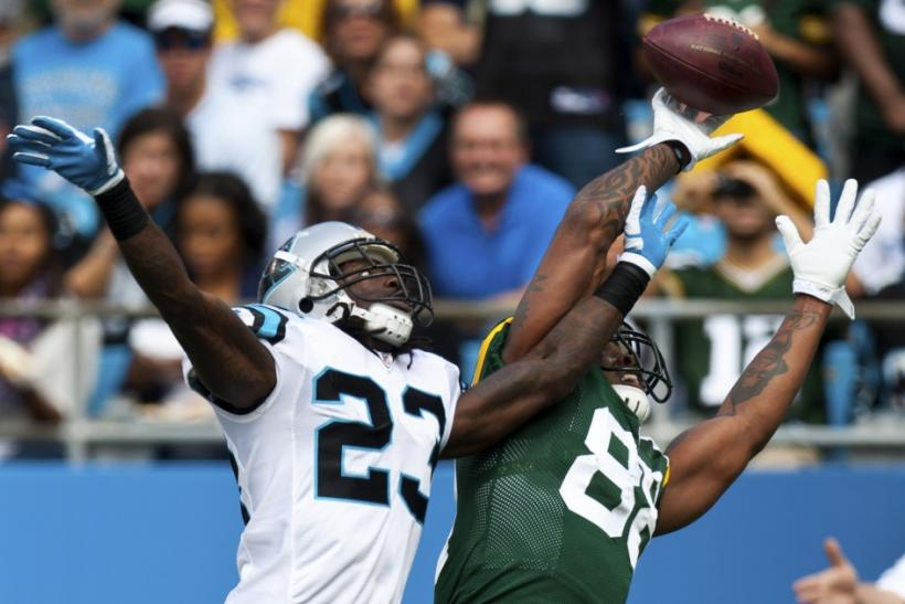 Green Bay Packers tight end Jermichael Finley works for a reception against Carolina Panthers free safety Sherrod Martin during their NFL football game in Charlotte