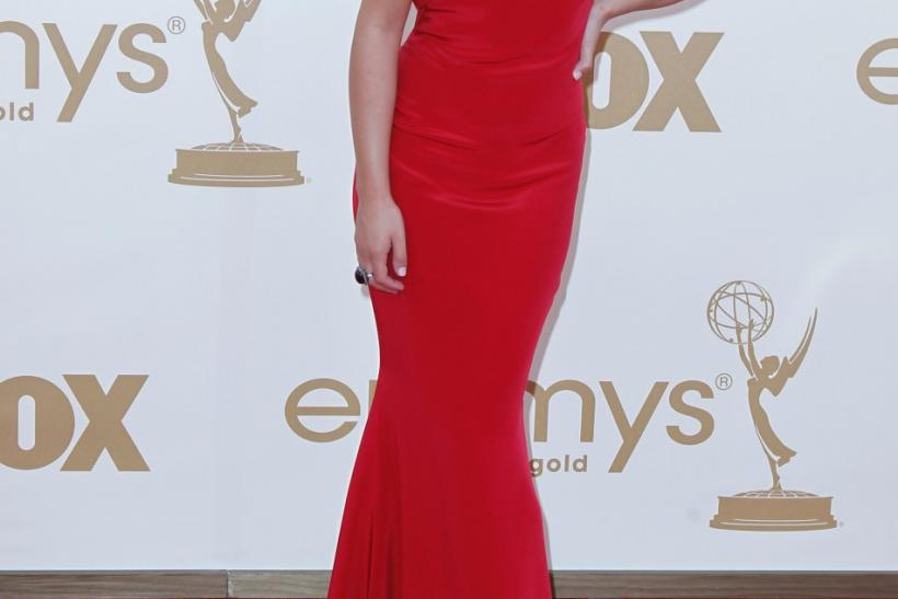 "Actress Lea Michele from ""Glee"" poses as she arrives at the 63rd Primetime Emmy Awards in Los Angeles September 18, 2011."