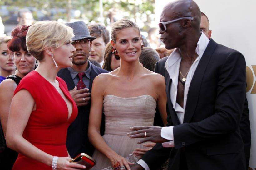 Actress Kate Winslet (L) talks with television host Heidi Klum (C) and Klum's husband and singer Seal (R) on the red carpet at the 63rd Primetime Emmy Awards in Los Angeles