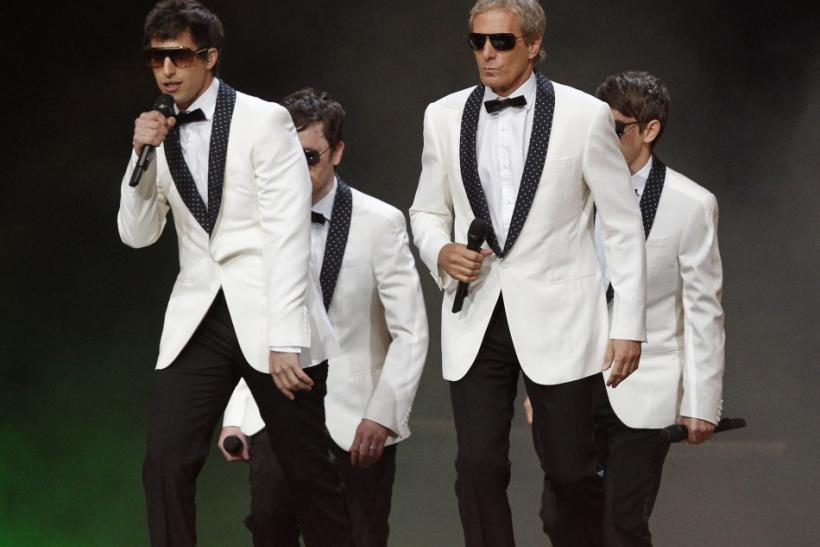 "Comedian Andy Samberg (L) and his group ""The Lonely Island"" perform with Michael Bolton (2nd R) perform at the 63rd Primetime Emmy Awards in Los Angeles"