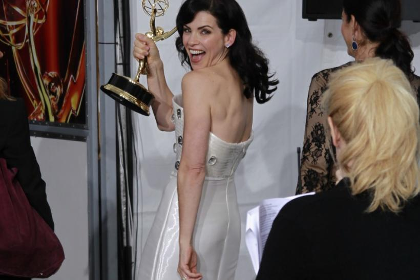 "Julianna Margulies walks with her Emmy award backstage after winning outstanding lead actress in a drama series for ""The Good Wife"" at the 63rd Primetime Emmy Awards in Los Angeles"