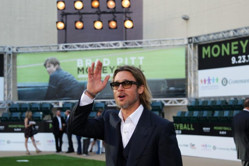 "U.S. actor Brad Pitt, who stars as Oakland Athletics' general manager Billy Beane, waves upon arrival for the world premiere of the film ""Moneyball"" in Oakland, California"