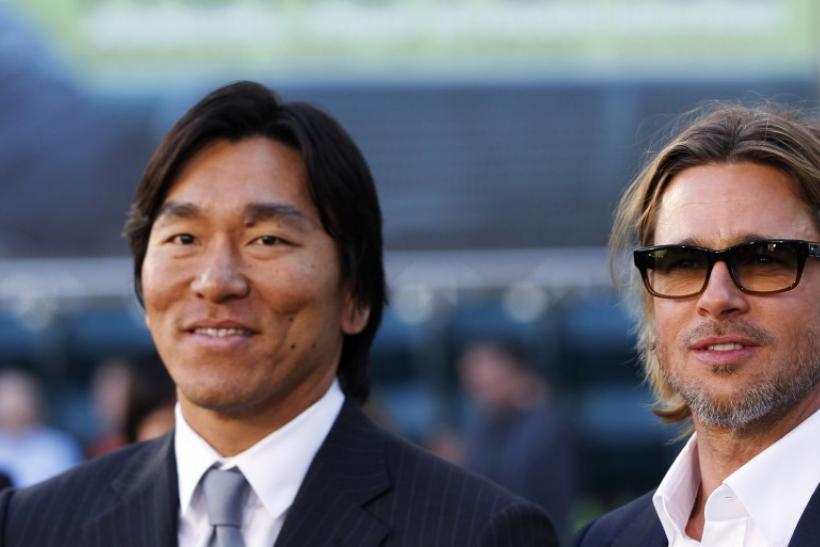 "U.S. actor Brad Pitt (R), who stars as Oakland Athletics' general manager Billy Beane, poses with current Oakland Athletics' designated hitter Hideki Matsui of Japan as they arrive for the world premiere of the film ""Moneyball"" in Oakland, Calif"