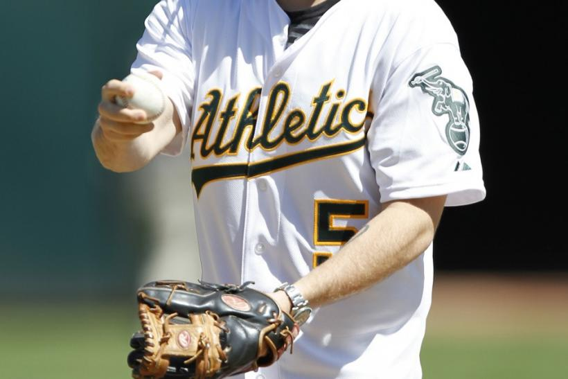 Actor Jonah Hill prepares to throw out the first pitch before the Oakland Athletics and Detroit Tigers MLB American League baseball game in Oakland, California