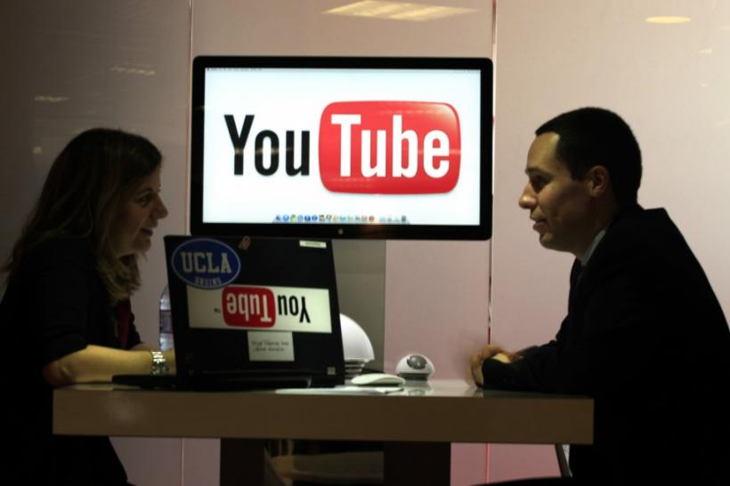 "Visitors are seen at ""You Tube"" stand during the MIDEM in Cannes"