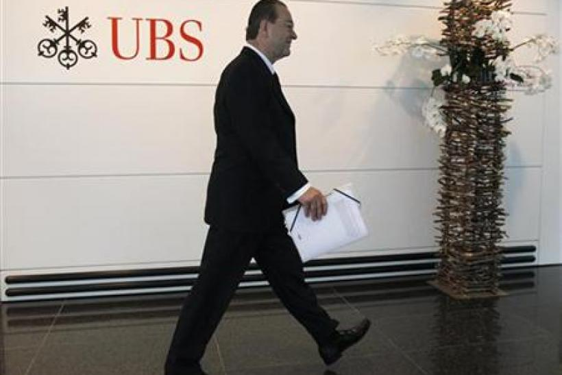 File photo of UBS CEO Grubel arriving for company results news conference in Zurich