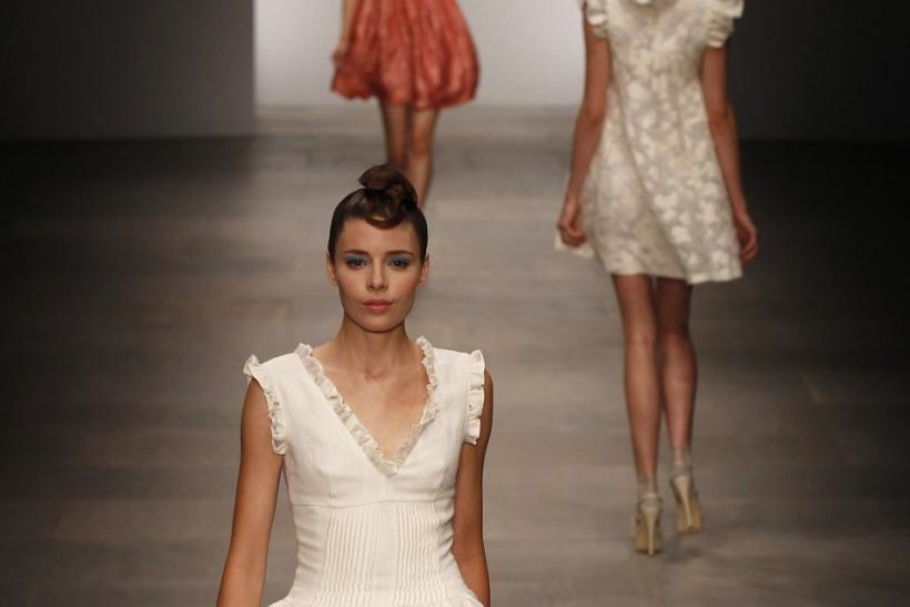 Models present creations from the Paul Costelloe 2012 Spring/Summer collection during London Fashion Week