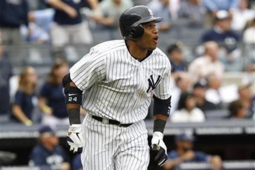 Yankees clinch playoff berth with comeback win