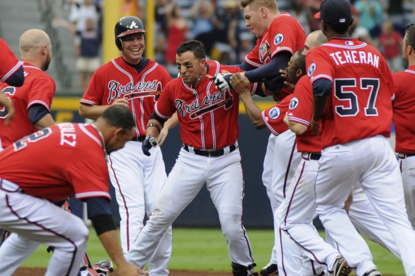 Braves batter Prado is mobbed by teammates after hitting a single scoring the winning run against the Dodgers in the ninth inning at Turner Field in Atlanta