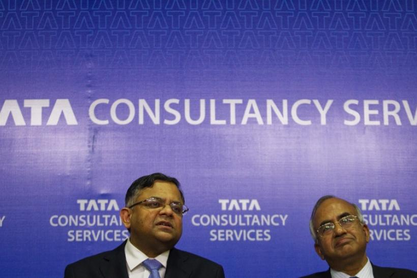 Chief Executive of Tata Consultancy Services Chandrasekaran and Chief Financial Officer Mahalingam attend a news conference to announce the company's Q4 results in Mumbai