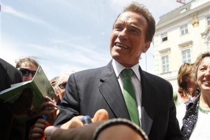 Former Governor of California Arnold Schwarzenegger shakes hands with fans at Ballhausplatz in Vienna