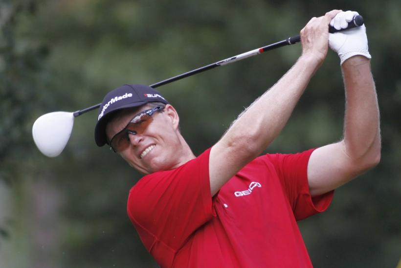 Senden of Australia hits off the fourth tee during round one of the Tour Championship PGA golf tournament in Atlanta.
