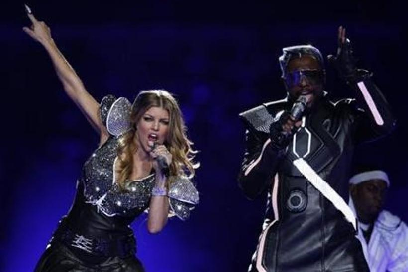 will.i.am and Fergie (L) of the Black Eyed Peas perform during the NFL's Super Bowl XLV football game's halftime show in Arlington, Texas