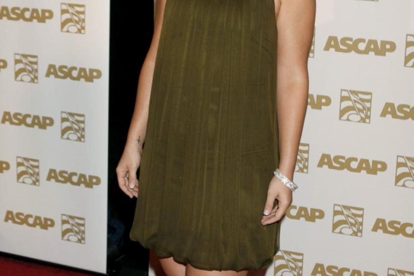 Singer Kelly Clarkson poses as she arrives at the ASCAP Pop Music Awards in Hollywood