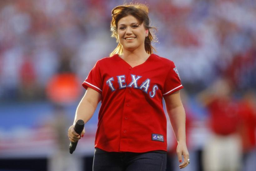Kelly Clarkson leaves the field after singing the national anthem before Game 3 of Major League Baseball's World Series between the Rangers and the Giants in Arlington
