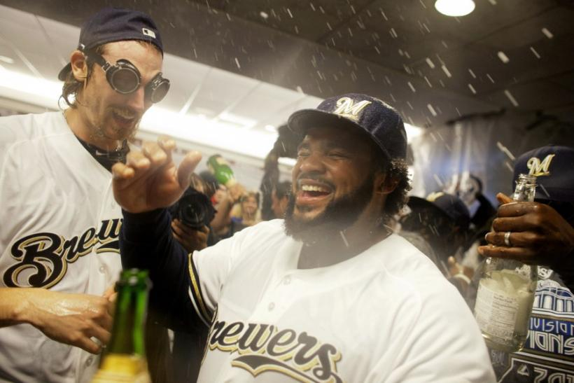 Milwaukee Brewers' Prince Fielder and John Axford along with the rest of the team celebrate in the locker room in Milwaukee