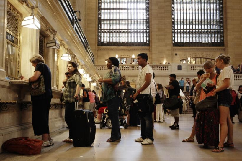 Travelers wait in line for Metro North tickets at New York's Grand Central Station