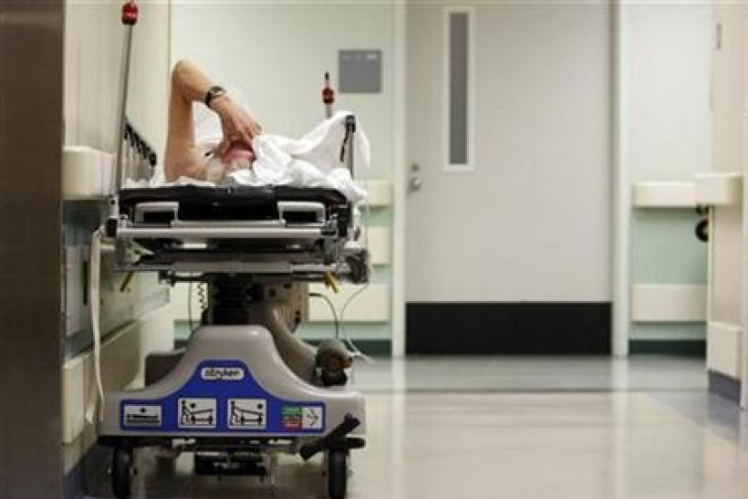 A patient waits in the hallway for a room to open up in the emergency room at Ben Taub General Hospital in Houston, Texas