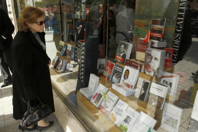 A woman looks in a bookstore window in Tunis