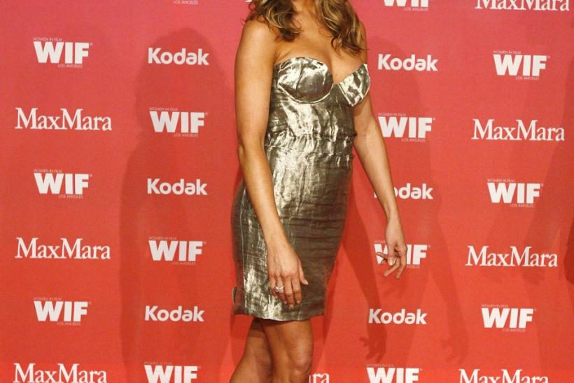 Jennifer Aniston poses at the Women in Film 2009 Crystal and Lucy Awards in Century City