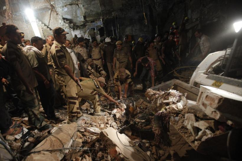 rescue and workers and search and for and survivors and under and the and rubble and collapsed and building and the and old and quarters and delhi and september and 28 and 2011.