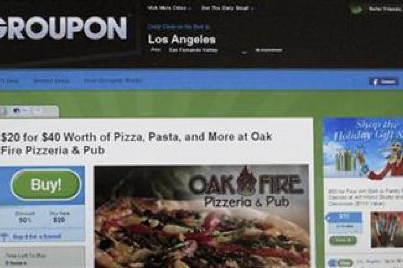 An online coupon sent via email from Groupon is pictured on a laptop screen in Los Angeles