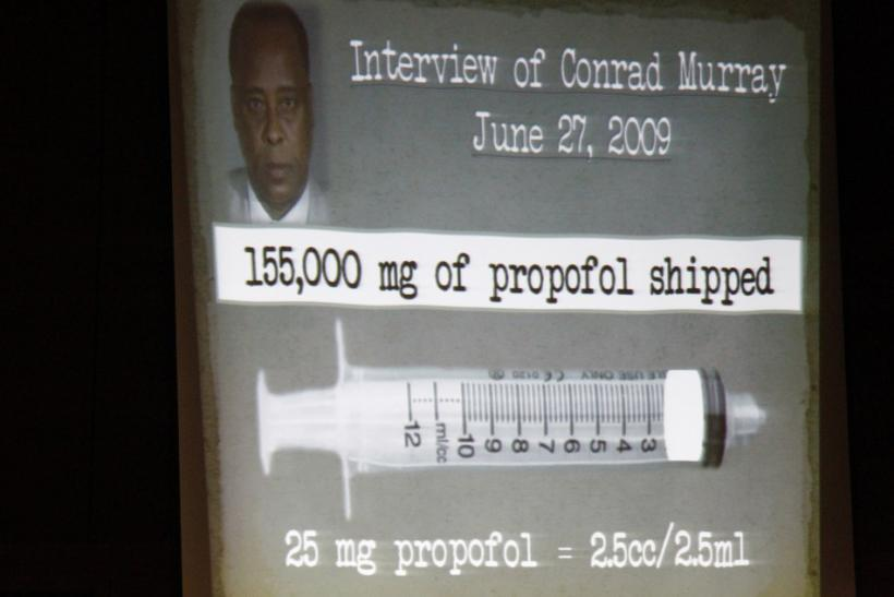 A slide projection of Conrad Murray and propofol is shown during the prosecution's opening argument in the Dr. Conrad Murray trial in the death of pop star Michael Jackson in Los Angeles