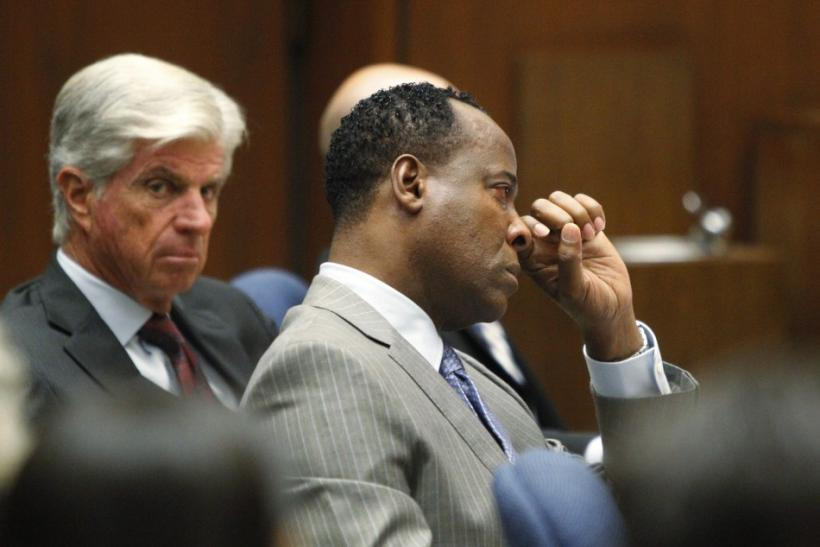 Dr. Conrad Murray wipes a tear during the opening arguments in his trial in the death of pop star Michael Jackson in Los Angeles