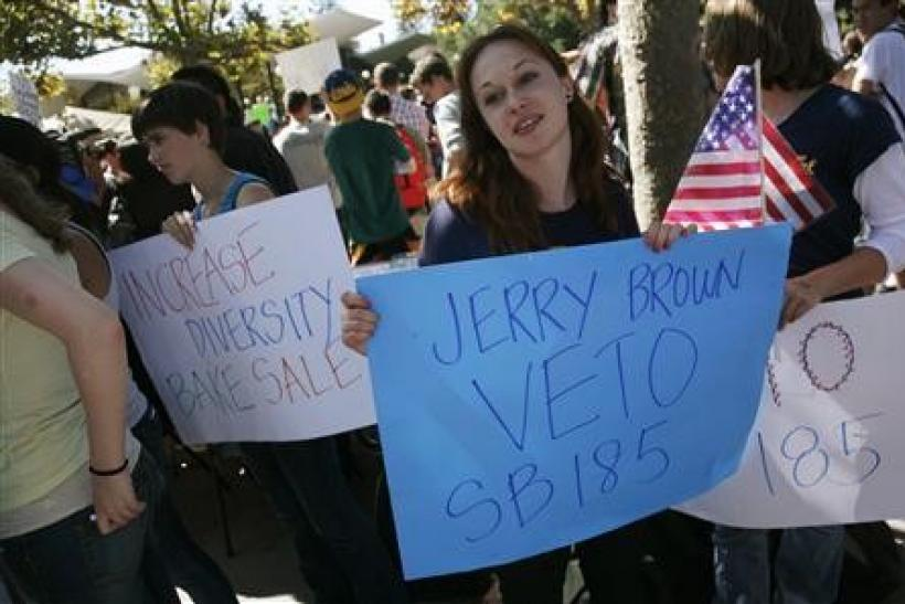 Students protest a bake sale on the campus of the University of California, Berkeley, in Berkeley, California