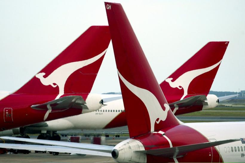 The tails bearing the logo of the 'Flying Kangaroo' of Qantas are seen at a terminal of Sydney Airport
