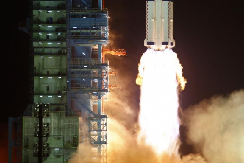 The Long March II-F rocket loaded with China's unmanned space module Tiangong-1 lifts off from the launch pad in the Jiuquan Satellite Launch Center, Gansu province