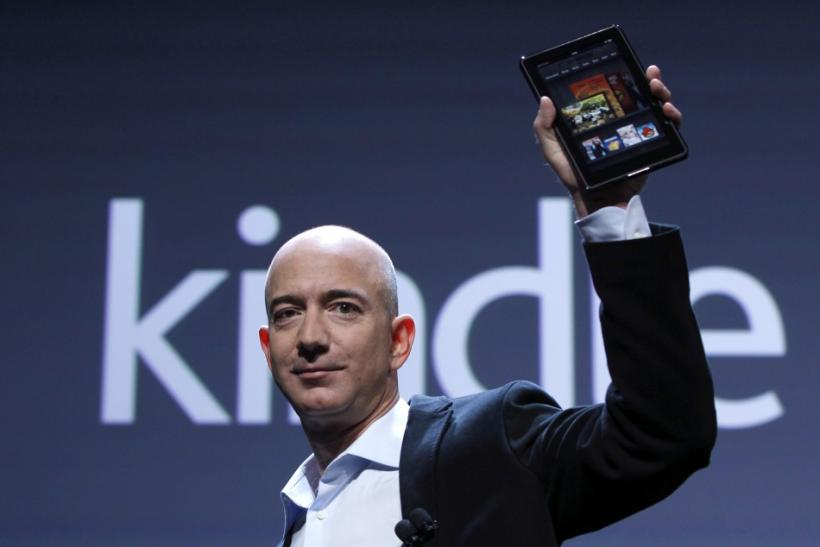 Amazon CEO Bezos holds up new Kindle Fire tablet at news conference in New York