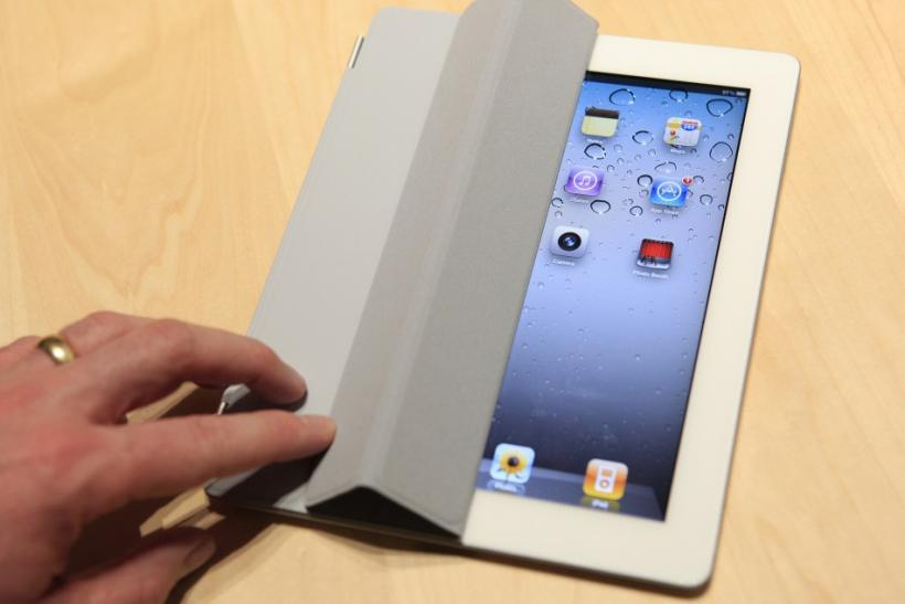 The iPad 2 with a Smart Cover is shown in use in the demonstration area after the iPad 2 launch during an Apple event in San Francisco