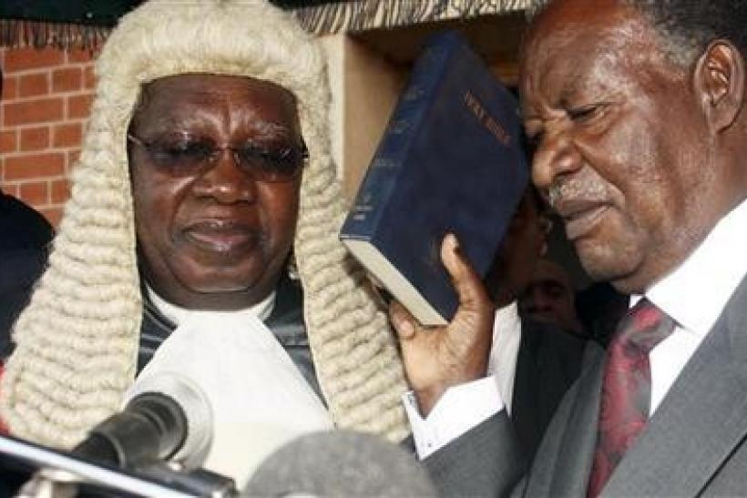 Zambian opposition leader Michael Sata (R) is sworn in as President at the supreme court in the capital Lusaka