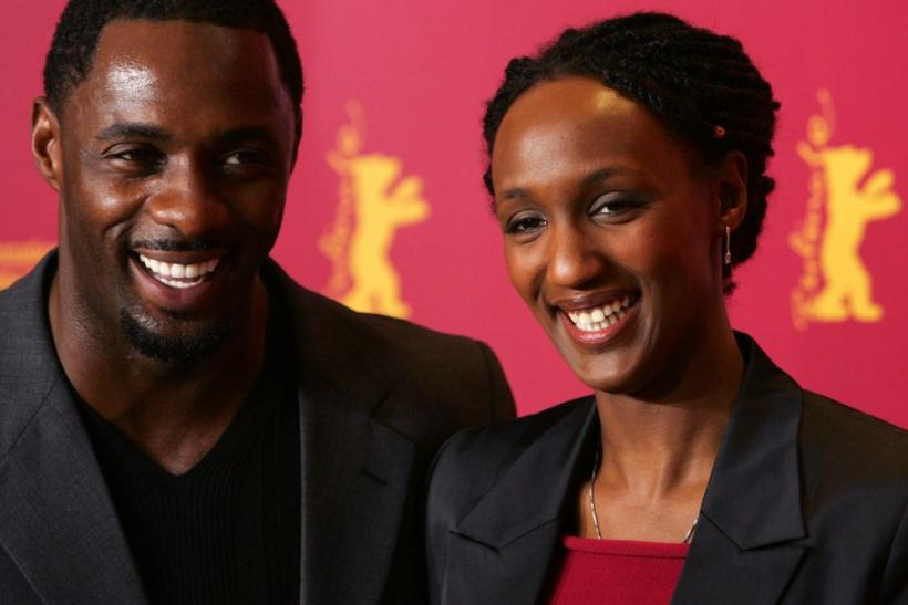 British actor Elba and actress Karemera from Rwanda pose during a photocall for the film 'Sometimes in April' in Berlin. British actor Idris Elba and actress Carole Karemera (R) from Rwanda pose during a photocall for the U.S./Rwanda film 'Sometimes in Ap