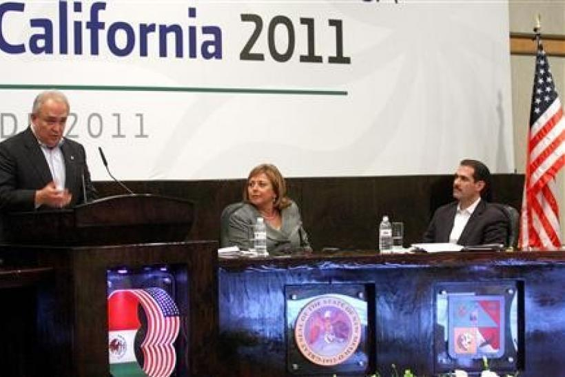 Governor of Baja California Guadalupe Osuna Millan (L) addresses the audience next to Governor of New Mexico Susana Martinez (C) and Governor of Sonora Guillermo Padres Elias at the annual conference of regional leaders from both sides of the border in So