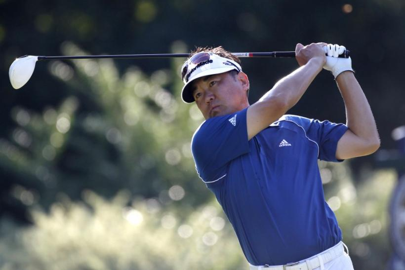 Charlie Wi of the U.S. tees off on the fifth hole during the first round of the 93rd PGA Championship golf tournament at the Atlanta Athletic Club in Johns Creek