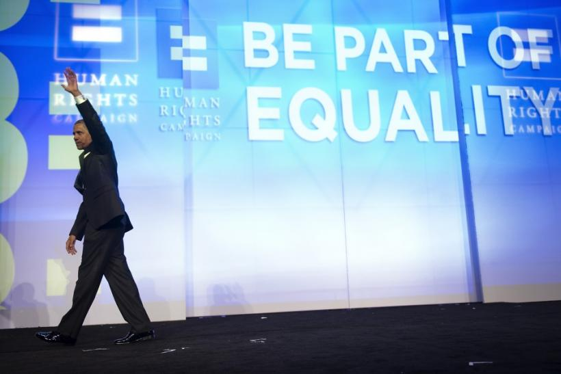 U.S. President Barack Obama departs after remarks at the Human Rights Campaign's annual dinner in Washington, October 1, 2011.