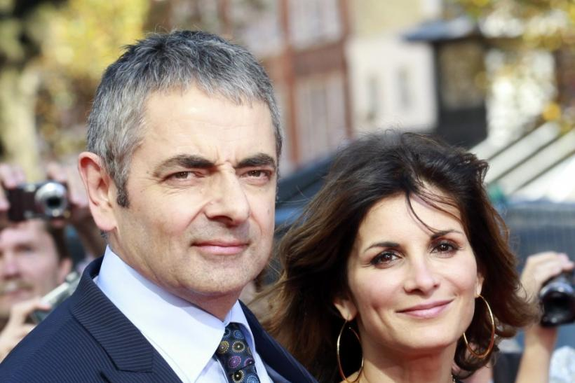 Actor Rowan Atkinson and his wife Sunetra Sastry arrive for the UK premiere of Johnny English Reborn, at the Empire Leicester Square in central London