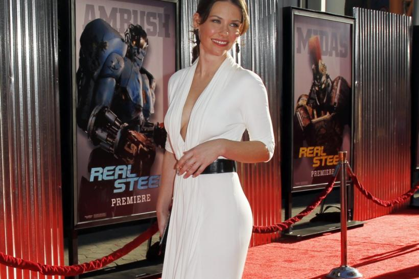 "Cast member Evangeline Lilly poses at the movie premiere of ""Real Steel"" in Los Angeles"