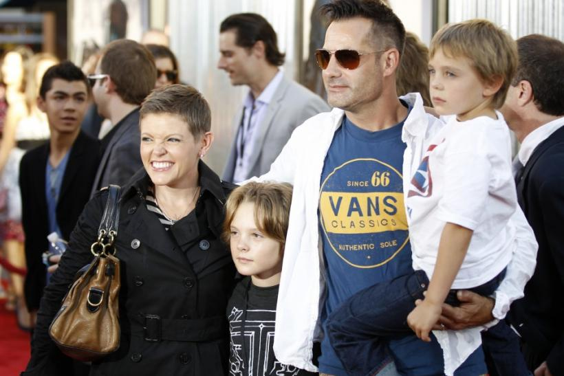 "Natalie Maines (L), lead singer for the band ""Dixie Chicks"", her husband actor Adrian Pasdar (2nd R), and their sons Jackson (2nd L) and Beckett (R) pose at the premiere of ""Real Steel"" in Los Angeles"