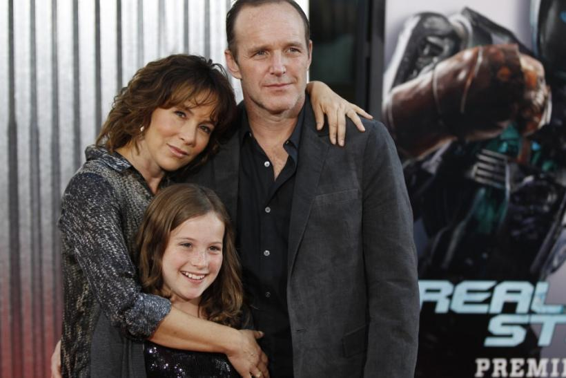 "Actress Jennifer Grey, husband actor Clark Gregg and their daughter Stella pose at the premiere of ""Real Steel"" in Los Angeles"