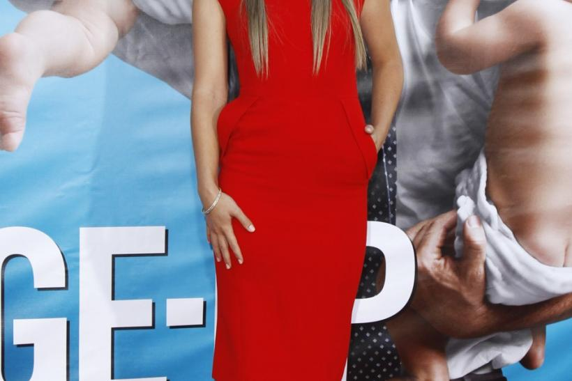 """Wilde poses at the world premiere of the film """"The Change-Up"""" in Los Angeles"""